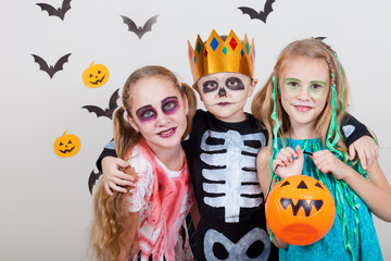 Wall Mural - Happy brother and two sisters on Halloween party