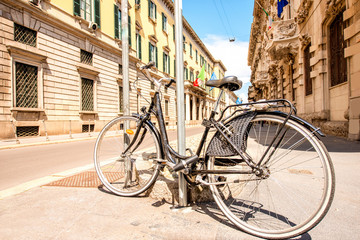 Bicycle on the street in the old city center of Milan in Italy