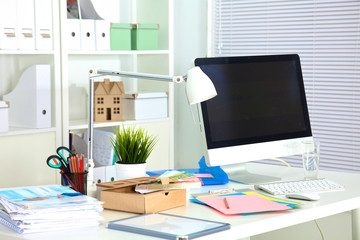 Designer working place with computer and paperwork