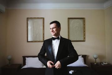 the groom wore a stylish black jacket