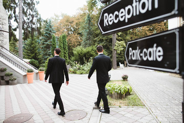 the groom and his friend go to hotel