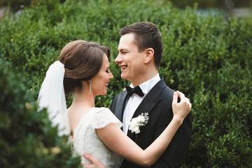 loving couple rejoice in botanical garden