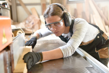 Young woman in crafstmanship school, training course Wall mural
