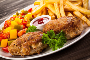 Fried chops, French fries and vegetable salad