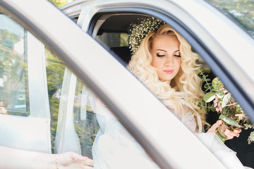 gentle and beautiful bride in the car