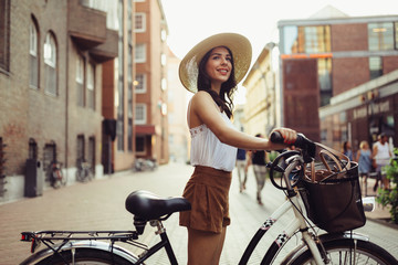 Attractive woman using bicycle