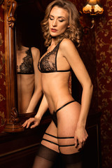 Young romantic girl in black lingerie