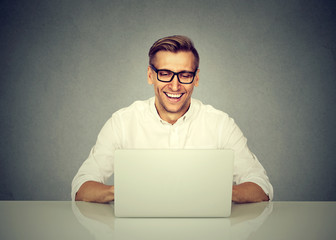business man working on laptop computer, smiling