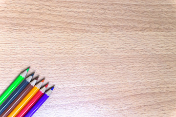 Color pencils on wood background / Colored pencils on wood background with space for your text