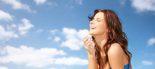happy beautiful woman over blue sky and clouds