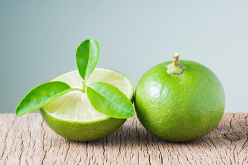 Fresh limes with it's leaf on wooden background ( Citrus aurantifolia (Christm.) Swingle ) , Rutaceae