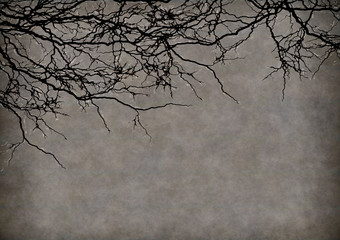 A halloween background of mottled brown and grey with tree branches