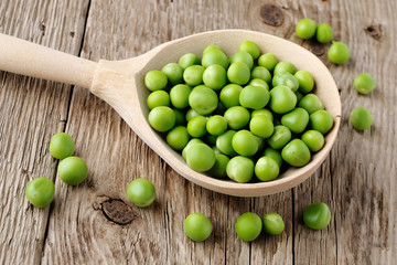 Peas in wooden spoon