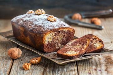 Chocolate cake with walnuts and orange peel.