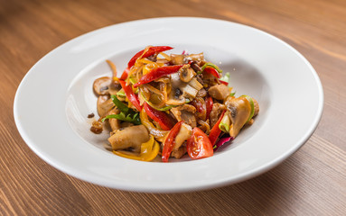 salad with mushrooms on white plate