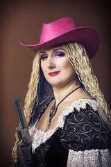 portrait of woman in pink hat with revolver