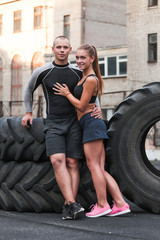 Athlete muscular sportsmen man and woman young couple Crossfit fitness sport training lifestyle bodybuilding concept