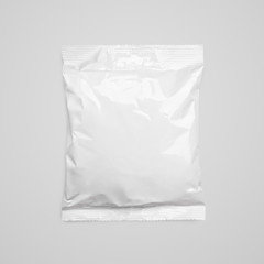 Top view of blank plastic pouch food packaging on gray with clipping path