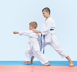 Elder brother teaches junior beat punch arm