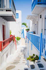 The narrow streets of the island with blue balconies, stairs and flowers. Beautiful architecture...