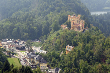 View of Hohenschwangau Castle in a summer misty day near the lake Alpsee in Bavaria, Germany.