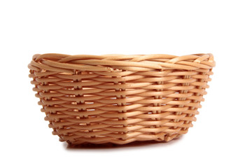 Wicker basket  for bread on white background