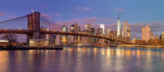 Panorama of Brooklyn Bridge and Manhattan skyscrapers at sunrise