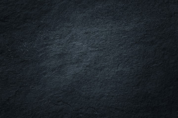 Dark grey black slate background or natural stone texture.