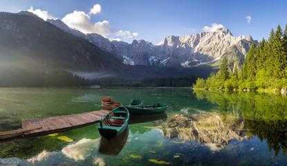 Alpine lake at dawn, beautifully lit mountains