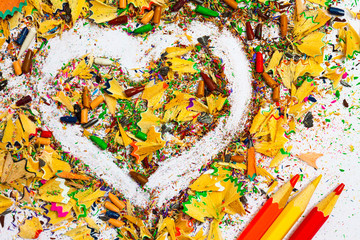 heart, multicolored pencils and varicolored shavings