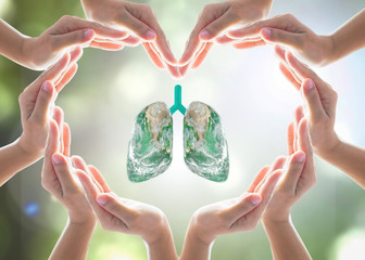 Healthy lung shape world design logo concept idea with heart-shape hands protection. Element of this image furnished by NASA