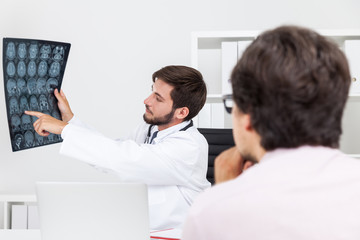 Doctor pointing at x ray
