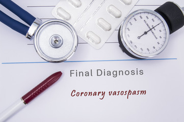 Paper medical form with a text diagnosis of Coronary vasospasm on which lie the stethoscope, blood pressure monitor, white tablets or pills in a blister pack and a red ballpoint pen