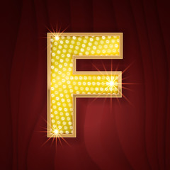 Gold light lamp bulb letter F