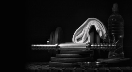 Equipment for strength training on a dark background.