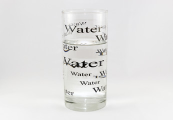 A glass of water with written. Concept of water