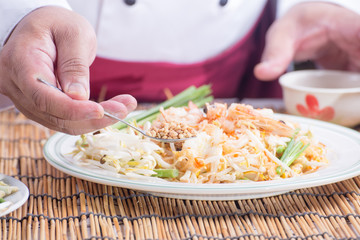 Chef decorated Pad Thai Menu with minced Peanut bean