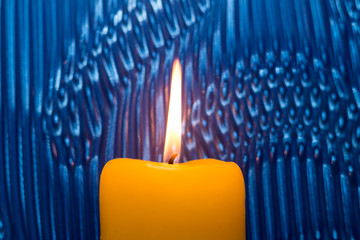 Candlelight on abstract background.