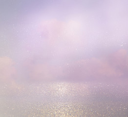 abstract photo of clouds burst in the sky. glitter overlay