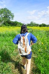 Woman walking travel in yellow garden
