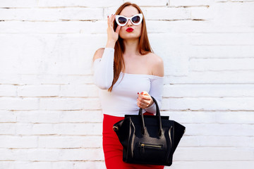 Wall Mural - Fashionable woman with trendy accessory bag send kiss