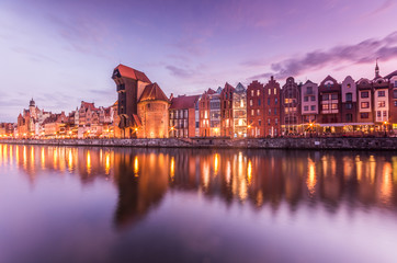 Photo on textile frame City on the water Gdansk old town with harbor and medieval crane in the evening