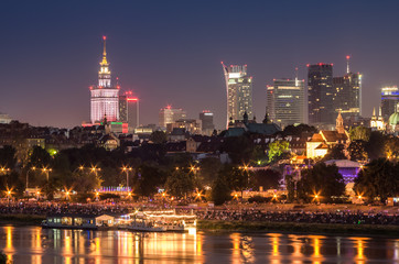 Fototapete - Night view of Warsaw waterfront and downtown skyline