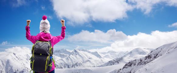 Happy winner on top of mountain