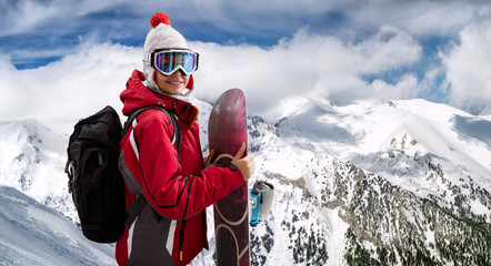 beautiful woman smiling and holding a snowboard