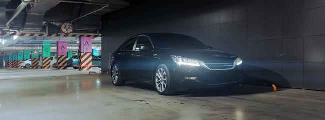 Black car in underground parking