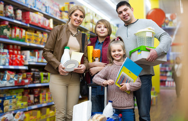 Portrait of  family with two children in local supermarket