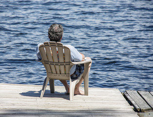 Man napping on dock in sunshine