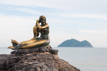 The mermaid statue on the rock