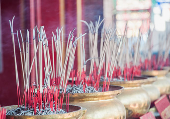 Group of joss stick in the golden pot at Chinese temple